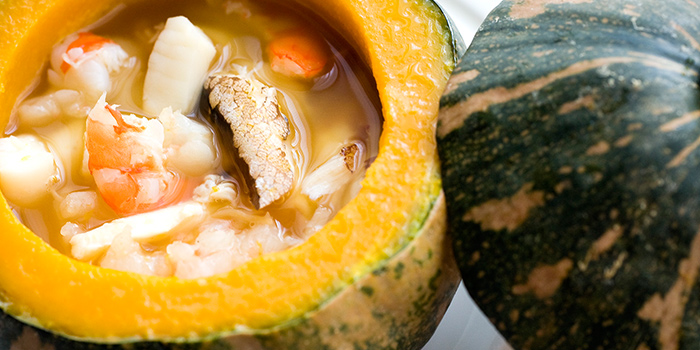 Braised Seafood Soup in Whole Pumpkin from Summer Palace serving Chinese cuisine in Regent Singapore in Tanglin, Singapore