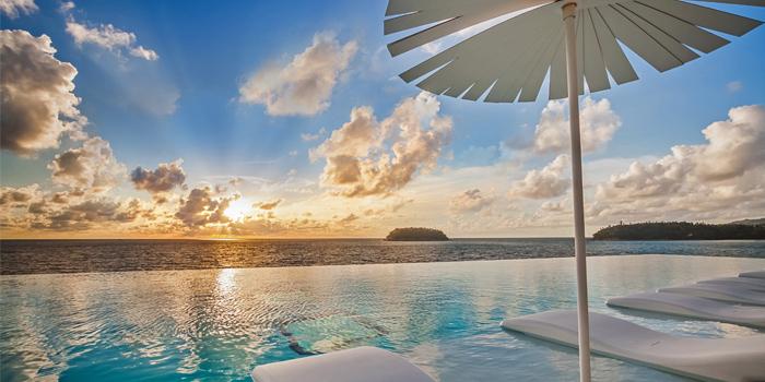 Pool Restaurant Sunset Umbrellee of Kata Rocks Oceanfront Restaurant in Kok-Tanode Road Karon Muang Phuket, Thailand