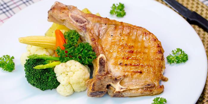 Grilled Pork Chop from Capri Noi Restaurant in Karon, Phuket, Thailand.