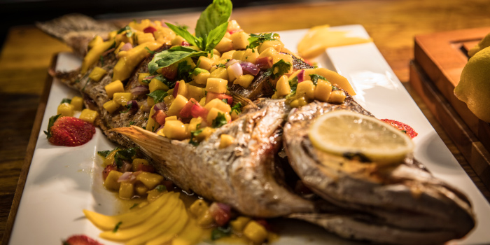 Deep Fried Whole Fish with Mango Salsa from BBQ Buffet from Catch Beach Club in Bangtao Beach, Cherngtalay, Phuket, Thailand.