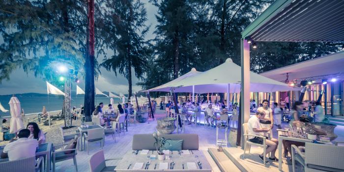 Evening Atmosphere of Catch Beach Club in Bangtao Beach, Cherngtalay, Phuket, Thailand.