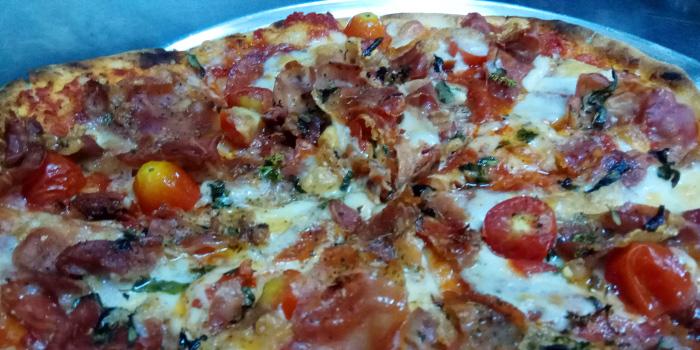 Salami Proscuto Pizza from The Deck Restaurant Kamala in Kamala, Phuket, Thailand.