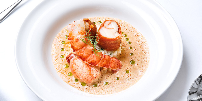 Prosciutto Ham Wrapped Monkfish and Maine Lobster on Risotto in Armagnac Bisque from Tablescape Restaurant & Bar at Grand Park City Hall in City Hall, Singapore