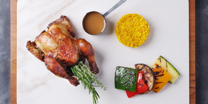 Baked-BBQ-free-range-whole-chicken from Sizzle Rooftop Restaurant in Tritrang, Patong, Phuket, Thailand.