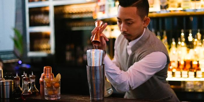 Bartender in Action from The Penthouse Grill at Park Hyatt Bangkok, Bangkok